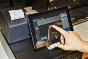 POS restaurant technology being used with integrated printer