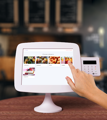 Self-service kiosks for contactless and table ordering in a bar
