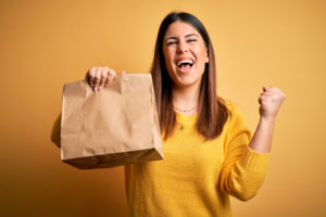 Food delivery with online ordering and last mile integration - Woman with takeaway bag