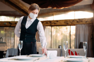Strict new coronavirus rules for restaurants and bars puts big focus on table ordering - Waitress with mask