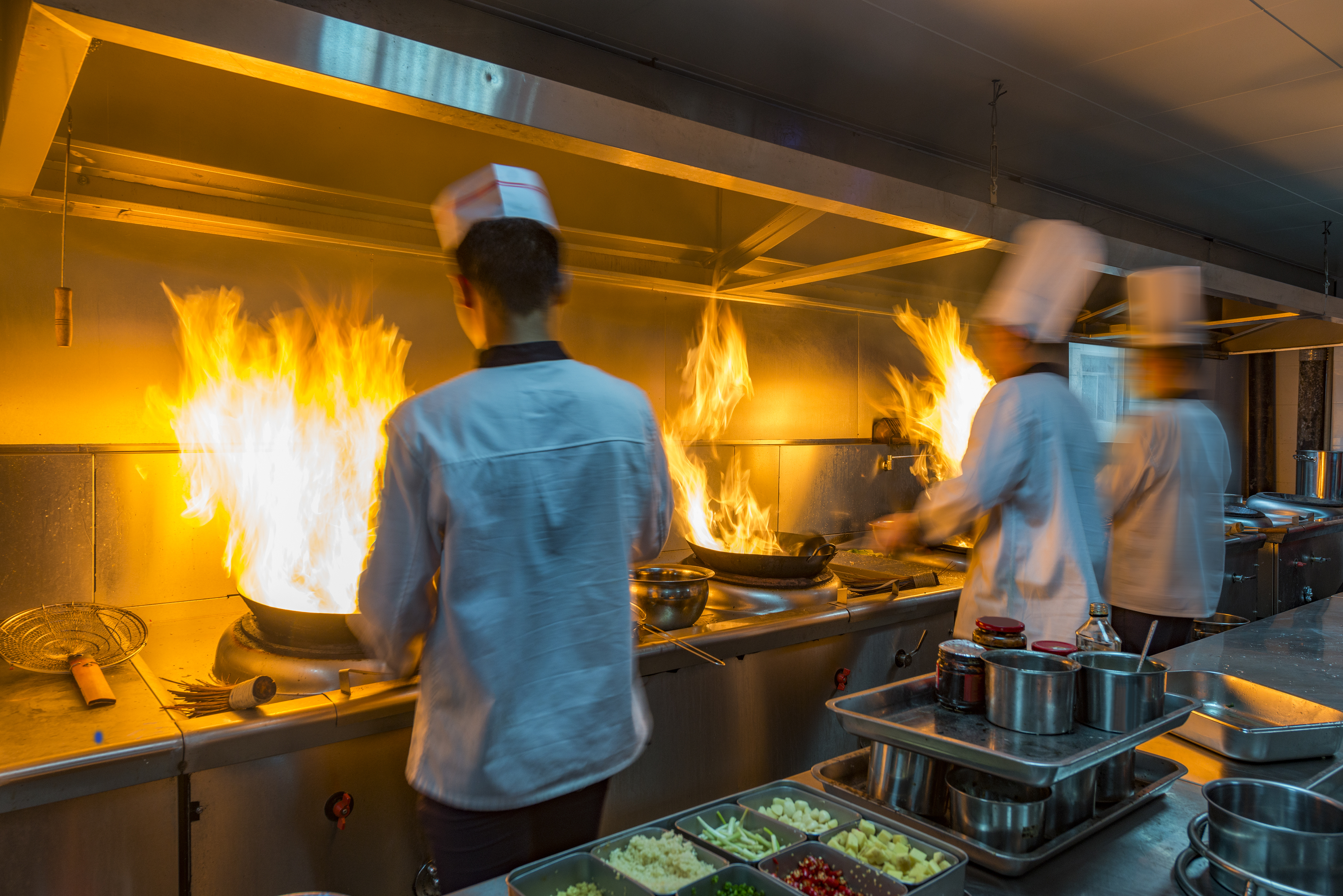 chefs in a kitchen working efficiently because of controlled order capacity mangment