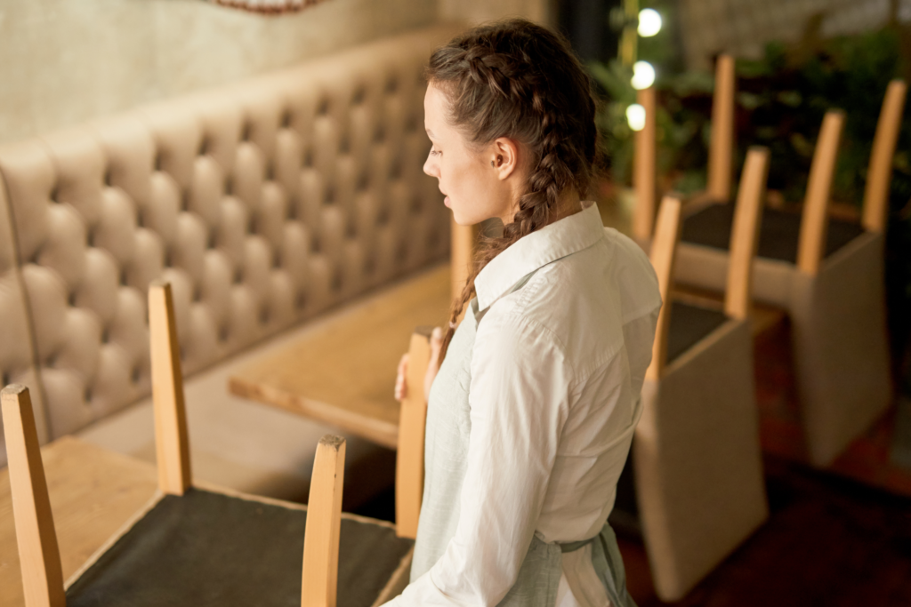 Backing local heroes in tough times - Waitress holding chair