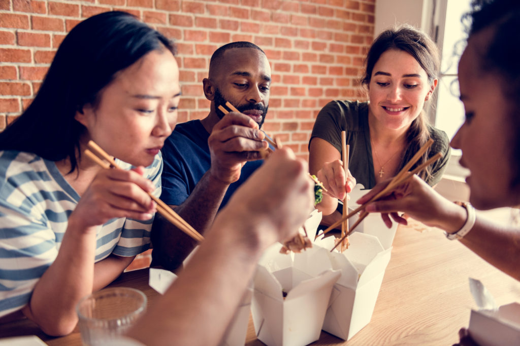 Friends eating dumplings together Chinese New Year Restaurant Marketing Ideas