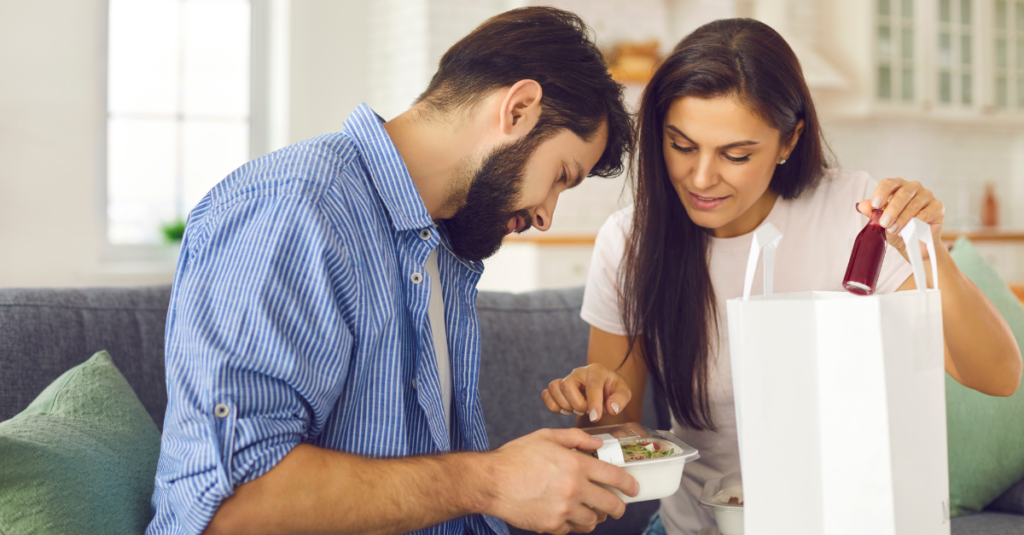 Couple looking at takeaway food