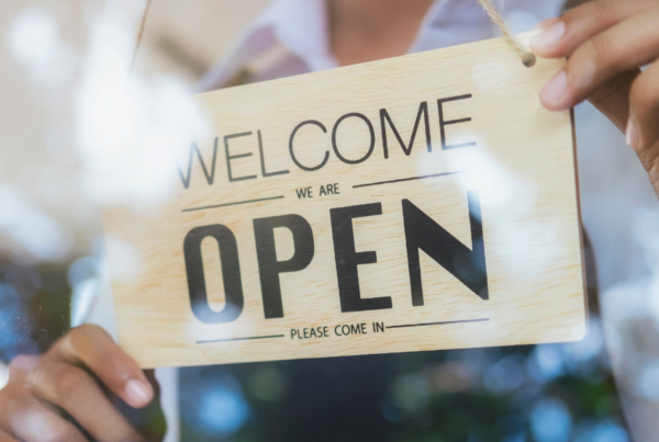 welcome we are open sign in business window
